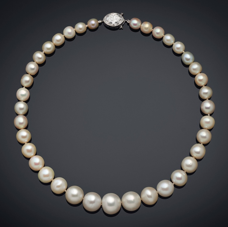 A natural pearl and diamond necklace, Cartier. 37 round to oval natural pearls of 14.00 to 7.05 mm, old-cut marquise-shaped diamond, platinum (French marks), 15¼  in. Estimate $1,000,000-1,500,000. Offered in Maharajas & Mughal Magnificence on 19 June 2019 at Christie's in New York