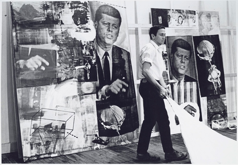 Robert Rauschenberg in his studio, 1964 (present lot illustrated). Photograph by Hans Namuth. Courtesy Center for Creative Photography, University of Arizona © 1991 Hans Namuth Estate