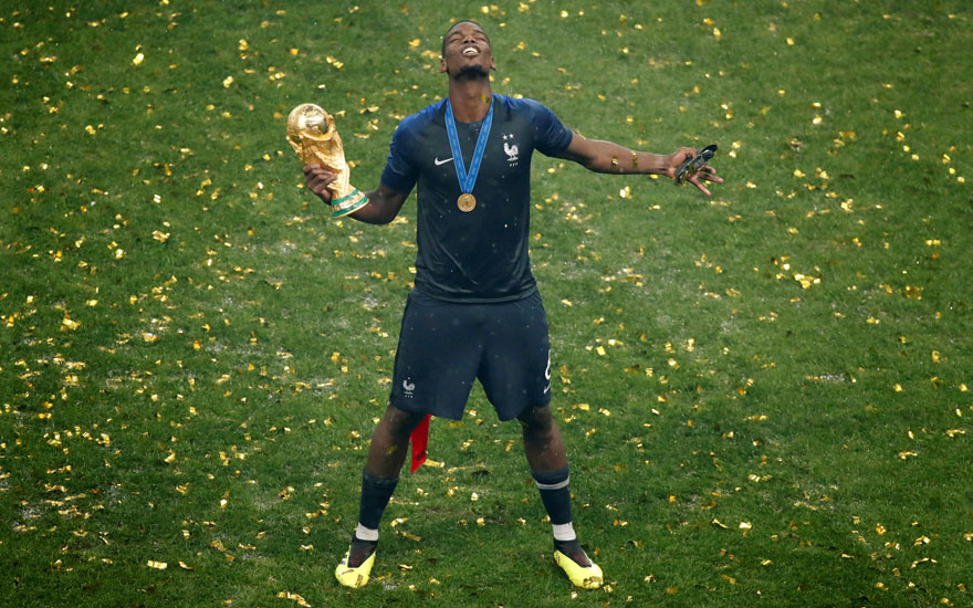 02cbce30c Paul Pogba — wearing the yellow boots offered at Chrisitie s on 29 April —  celebrates France s