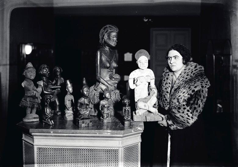 Jeanne Walschot with pieces from her extensive collection of African art, photographed circa 1931. Photograph taken by Germain Van Parys. Photo GERMAINIMAGE