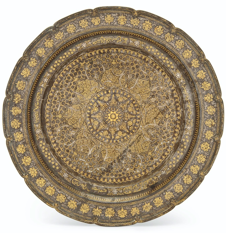 A gold and silver-decorated steel dish, North india, 19th century. 15⅞ in (40.5 cm) diam.