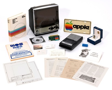 This lot includes an Apple photo slide (right, in box) of the original Apple logo that was created and drawn by Apple co-founder Ronald G. Wayne after Apple was incorporated on January 3, 1977; and a pristine, working Panasonic RQ-309DS Cassette Tape Recorder for the Apple-1