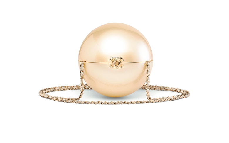 916353b5d884 A runway iridescent white lucite Pearl clutch with light gold hardware,  Chanel, Cruise 2015