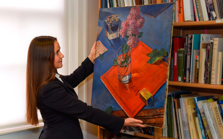 Russian Art specialist Aleksandra Babenko with Kuzma Petrov-Vodkins Still Life with Lilac. Sold for £9,286,250 in Russian Art on 3 June 2019 at Christie's in London