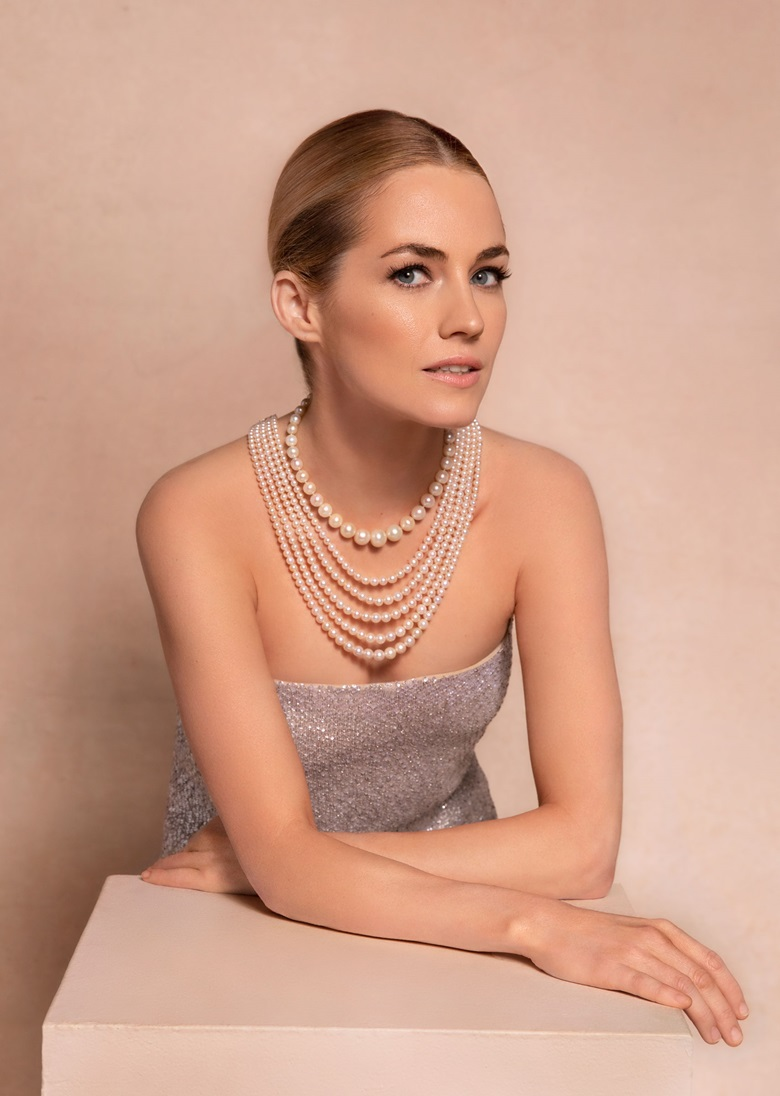 Amanda wears a natural pearl and diamond necklace, Cartier. Estimate $1,000,000-1,500,000; a five-strand natural pearl and diamond necklace, Bhagat. Estimate $800,000-1,200,000. Offered in Maharajas & Mughal Magnificence on 19 June 2019 at Christie's in New York