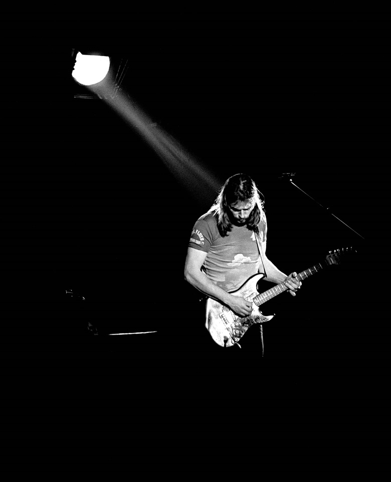 David Gilmour performing live at Wembley Empire Pool, London, in March 1977 on the Animals — In The Flesh tour. Photo by Andre CsillagREXShutterstock