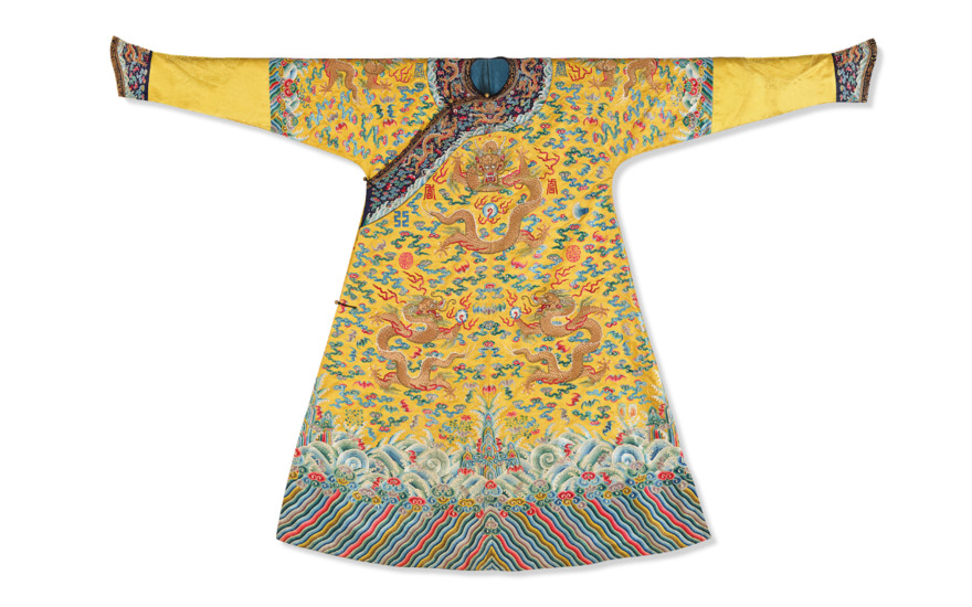 A magnificent imperial yellow embroidered satin 'Twelve Symbol' dragon robe, Longpaochina Qing Dynasty. Estimate €80,000-120,000. Offered in Art dAsie on 12 June at Christies in