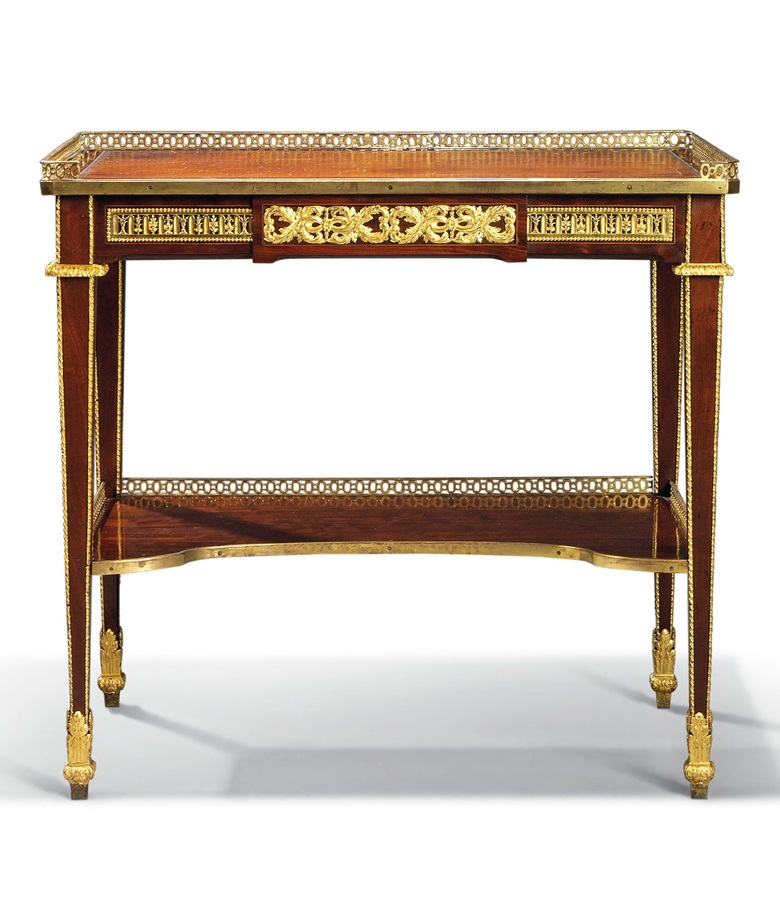 A royal Louis XVI ormolu-mounted mahogany, ebony and fruitwood writing table, by Jean-Henri Riesener, circa 1785. 30 in (76.2 cm) high; 31¾  in (80.6  cm) wide; 19  in (48.3 cm) deep. Sold for £1,091,250 in Masterpieces from a Rothschild Collection on 4 July 2019 at Christie's in London