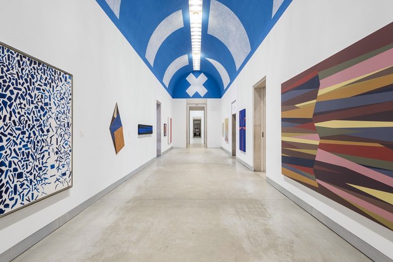 Philadelphia Museum of Art. Installation view of the Tuttleman Gallery featuring, clockwise from left to right, Alma Thomas, Hydrangeas Spring Song, 1976; Dorothea Rockburne, Robe Series, The Descent, 1976; Leo Valledor, The Calm, 1966; Sol LeWitt, On a Blue Ceiling, Eight Geometric Figures Circle, Trapezoid, Parallelogram, Rectangle, Square, Triangle, Right Triangle, X (Wall Drawing No. 351),