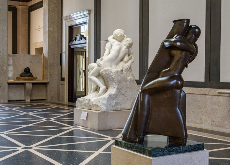 Installation view of Rethinking the Modern Monument, Rodin Museum. Visible is a copy of Rodin's The Kiss, 1929 and Chana Orloff, The Dancers (Sailor and Sweetheart), modelled 1923, cast in bronze 1929. Image courtesy of Philadelphia Museum of Art, 2019. Photo by Timothy Tiebout. Artwork © Chana Orloff, DACS 2019