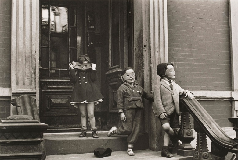 Helen Levitt (1913-2009), New York (Children in Masks), c. 1940. Gelatin silver print, printed later. Image 8 x 12 in (20.2 x 30.5 cm); sheet 11 x 14 in (28 x 35.7 cm); Estimate $8,000-10,000. Offered in Photographs New York, New York on 16-24 July, Online. © Helen Levitt Film Documents LLC. All rights reserved
