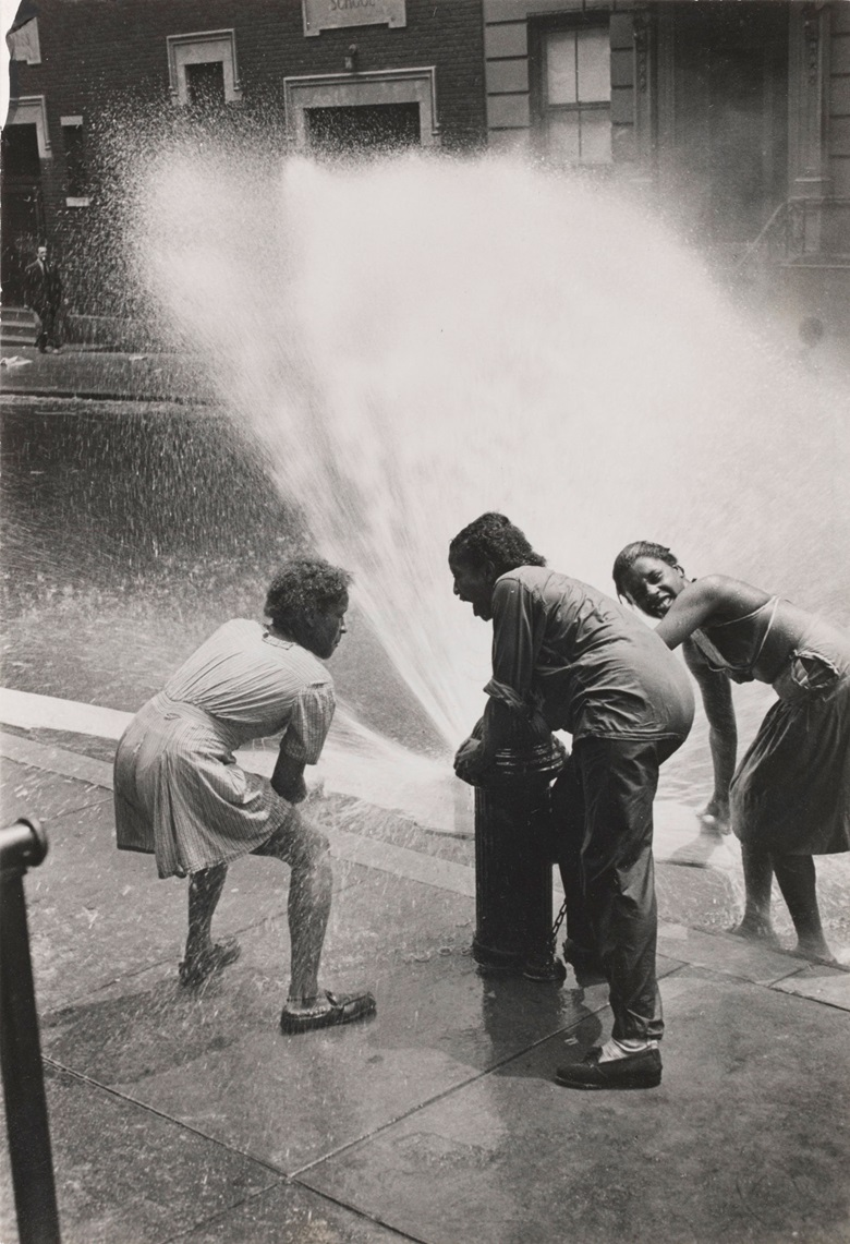 Helen Levitt (1913-2009), New York (Children in Fire Hydrant Spray), c. 1945. Gelatin silver print. Imagesheet 8¼ x 5⅝ in (20.9 x 14.2 cm). Estimate $7,000-8,000. Offered in Photographs New York, New York on 16-24 July, Online. © Helen Levitt Film Documents LLC. All rights reserved