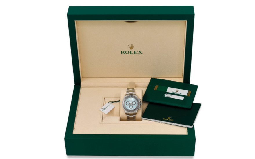 Rolex. an extremely fine and very rare platinum automatic chronograph wristwatch with ice blue dial, eastern arabic numerals, brown ceramic bezel, bracelet, guarantee and box, ref 116'506,