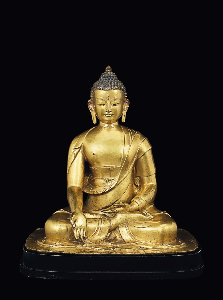 A rare gilt-bronze figure of Buddha Ratnasambhava, Nepal, 17th-18th century. Height 46 cm (18⅛ in). Estimate $700,000-900,000. Offered in Indian, Himalayan and Southeast Asian Works of Art on 11 September 2019 at Christie's in New York