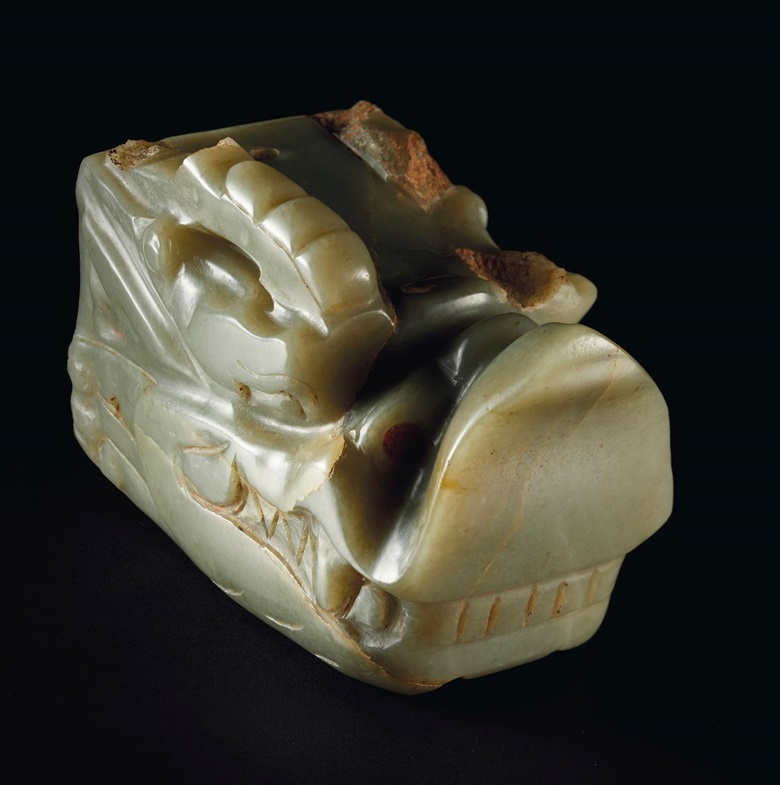 An exceptionally rare and highly important pale greyish-green jade carving of a dragon head, Tang dynasty (AD 618-907). 6½ in (16.5 cm) long. Estimate $2,500,000-3,500,000. Offered in Important Chinese Ceramics and Works of Art on 13 September at Christie's in New York