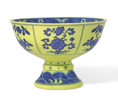 A very rare underglaze-blue-decorated yellow-enameled stem bowl. Qianlong six-character seal mark in underglaze blue in a line and of the period (1736-1795). Diameter 7  in (17.8  cm). Estimate $100,000-150,000. Offered in Chinese Art from The Art Institute of Chicago  on 12 September 2019 at Christie's in New York