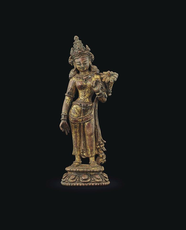 A gilt-bronze figure of Tara. Nepal, 13th-14th century. 5¼ in. (13 cm.) high. Estimate $25,000-35,000. Offered in Indian, Himalayan & Southeast Asian Works of Art on 11 September at Christies in New York