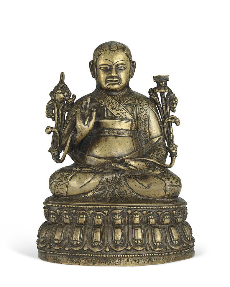 A silver and copper inlaid figure of Lowo Kenchen Sonam Lhundrup (circa 1441-1532). Central Tibet, Tsang atelier, 16th century. 6⅞ in. (17.5 cm.) high. Estimate $30,000-50,000. Offered in Indian, Himalayan & Southeast Asian Works of Art on 11 September at Christies in New York