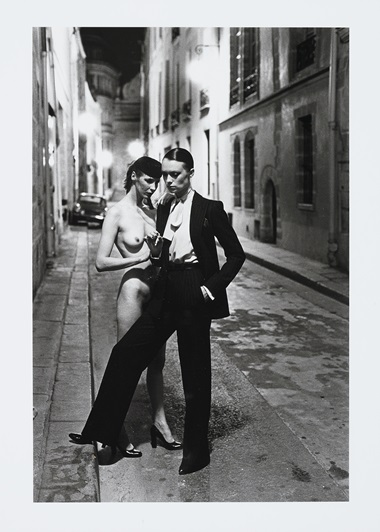 Helmut Newton (1920-2004), Yves St. Laurent, Rue Aubriot, French Vogue, Paris, 1975. Gelatin silver print. Sheet 14 x 10⅞ in (35.5 x 27.3 cm). Estimate $15,000-25,000. Offered in Photographs on 2 October 2019 at Christie's in New York
