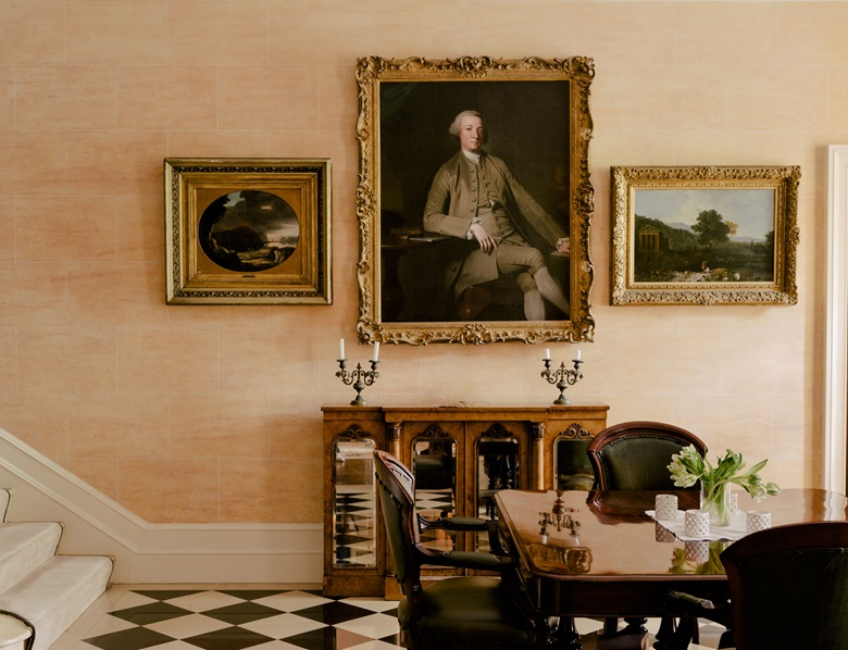 Two paintings by Richard Wilson, Eruption at Lake Avernus, circa 1771, and The Temple of Citumnus, circa 1754, flank George Romney's work of circa 1765-67, Portrait of a Seated Gentleman, possibly William Sudden of Lancaster