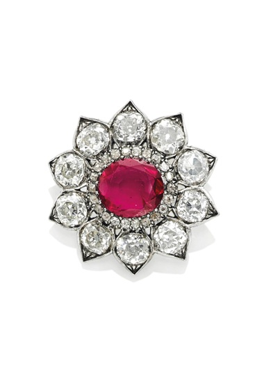 A ruby and diamond broochpendant. Sold for CHF 365,000 on 18 May 2016 at Christie's in Geneva