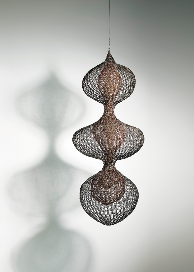 Ruth Asawa (1926-2013), Untitled S.387 (Three Lobed Continuous Form with Two Interior Lobed Continuous Forms) circa 1955. Hanging sculpture copper, brass, and gold wire. 34½ x 15 x 15 in (87.6 x 38.1 x 38.1 cm) Sold for $4,095,000 on 14 November at Christie's in New York. © Estate of Ruth Asawa