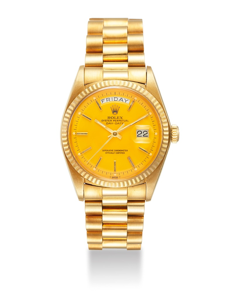 Rolex. A very fine and very rare 18k gold automatic wristwatch with a yellow lacquered 'Stella' dial, sweep centre seconds, day, date, signed Rolex, Oyster Perpetual, Day-Date, superlative chronometer, officially certified, Ref. 1803, case no. 5'107'722, circa 1977. Sold for $131,250 on 22 March 2019 at Christie's in Dubai