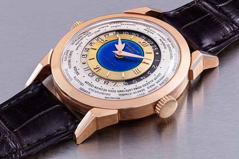 Patek Philippe. A unique and highly important 18k pink gold two-crown world time wristwatch with 24-hour indication and double-signed blue enamel dial, retailed by Gobbi, Milan, 'Heures Universelles', Ref. 2523, manufactured in 1953. Sold for HK$70,175,000 on 23 November at Christie's in Hong Kong