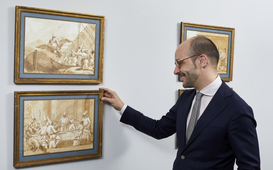 Old Master Drawings specialist Stijn Alsteens with a group of Giovanni Domenico Tiepolo's Punchinello drawings at Christies