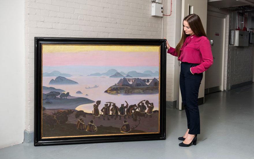 Specialist Aleksandra Babenko with Nicholas Roerich's Call of the Sun, 1919, offered at Christie's in London on 25 November in the Important Russian Art auction