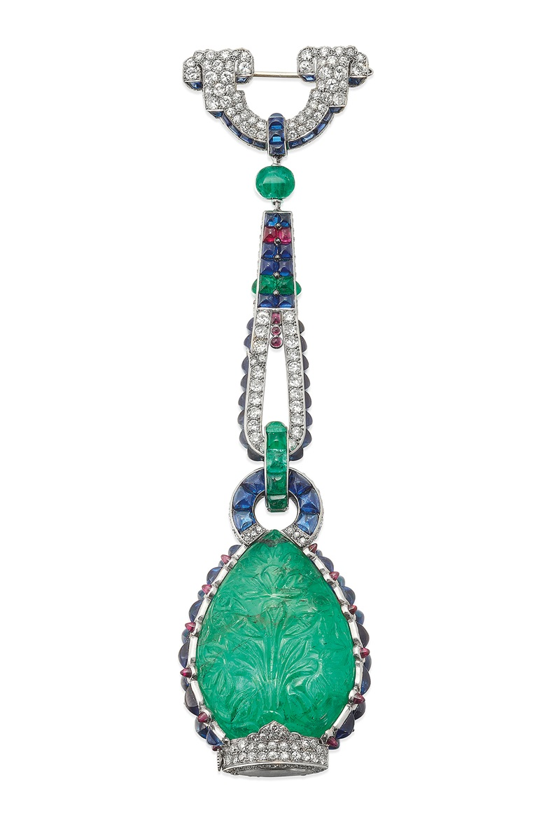 An exquisite and very rare multigem and diamond Art Deco fob watch, Cartier. Estimate £800,000-1,500,000. Offered in Important Jewels on 27 November 2019 at Christie's in London