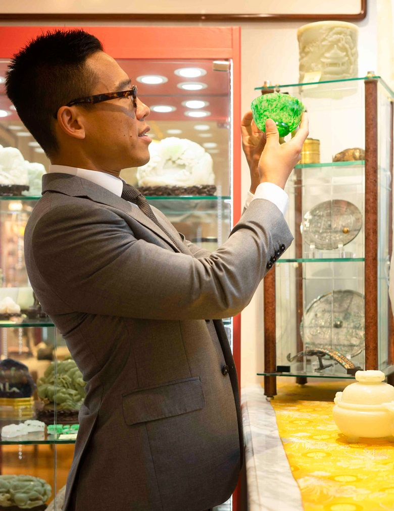 Ruben Lien with pieces from the jade collection of Mr Robert Chang, to be exhibited at Christie's Hong Kong in 2020. Photograph by Jingya Liu