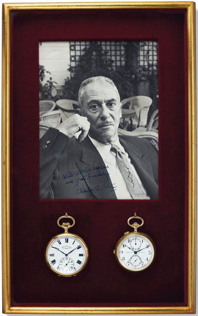 The two watches in a frame together with a signed photograph of Charles Ritz