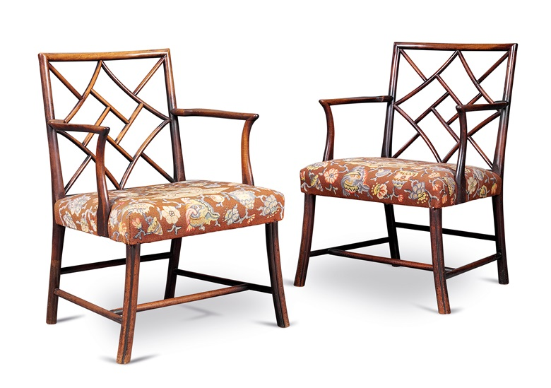 A pair of George III mahogany cockpen armchairs, circa 1760, possibly Scottish, the needlework by H.R.H. the Duchess of Gloucester, later Princess Alice (1901-2004). 34¾ in (88  cm) high; 24 in (61 cm) wide; 22¾ in (58 cm) deep. Estimate £5,000-8,000. Offered in Property from Descendants of Their Majesties King George V and Queen Mary on 13 December 2019 at Christie's in London