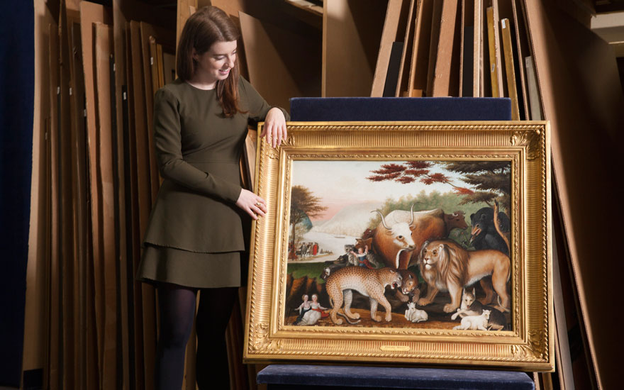 Sallie Glover with Edward Hicks' Peaceable Kingdom, painted in 1844-1846. Offered in Important American Furniture, Folk Art and Silver on 24 January 2020 at Christie's in New York