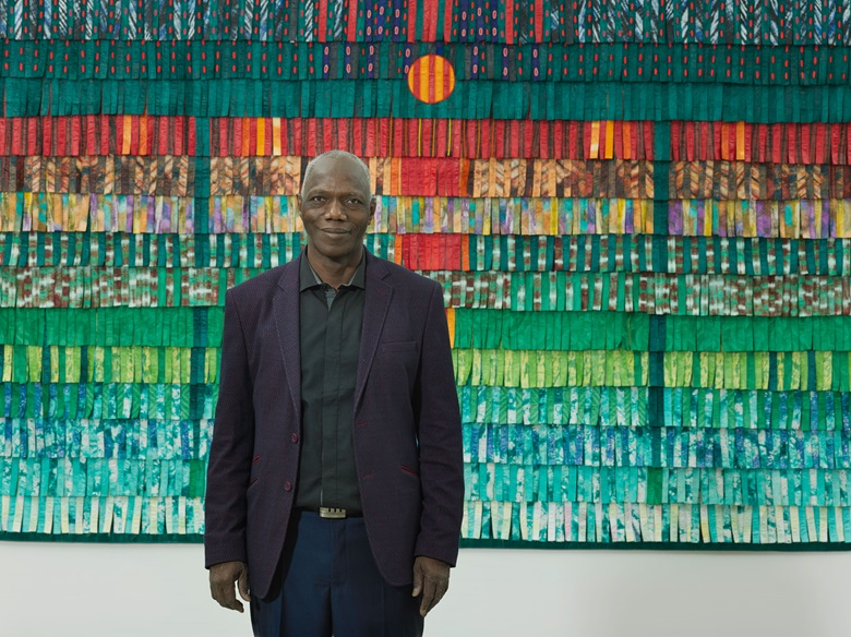 Abdoulaye Konaté with Composition vert émeraude et rouge, 2016. Courtesy the artist and Blain Southern. Photo Peter Mallet