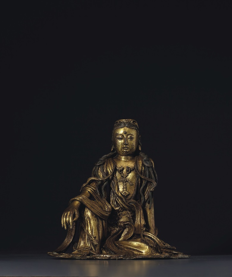 A very rare gilt-bronze figure of white-robed Guanyin, China, Ming dynasty, 15th century. 10⅛ in (25.6 cm) high. Estimate $400,000-600,000. Offered in Sacred and Imperial The James and Marilynn Alsdorf Collection Part I  on 24 September 2020 at Christie's in New York