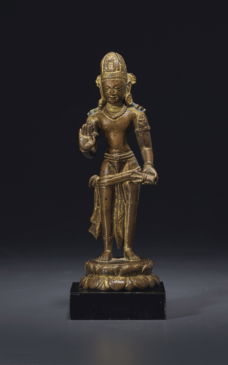 A rare gilt-bronze figure of Vajrapani, Nepal, Licchavi Period, 9th-10th century. 9½ in (24.1 cm) high. Estimate $60,000-80,000. Offered in Sacred and Imperial The James and Marilynn Alsdorf Collection on 24 June at Christie's in New York
