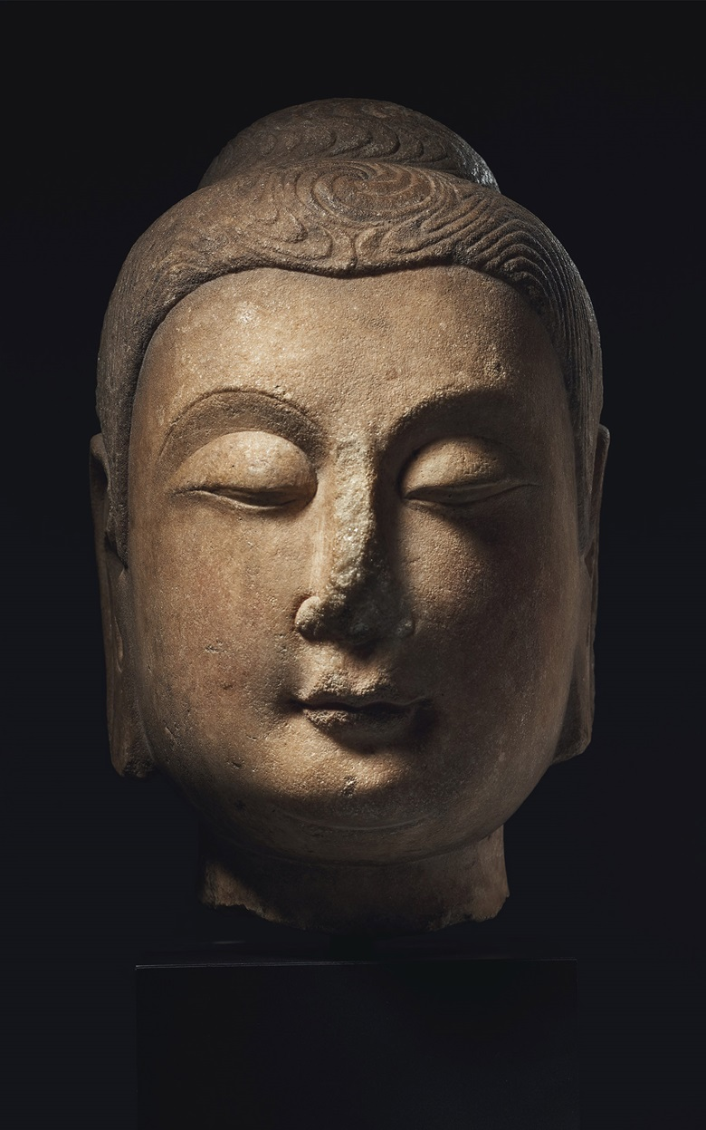 A very rare and important marble head of Buddha, China, Sui dynasty (AD 550-618). 11¾ (29.9 cm) high. Estimate $500,000-700,000. Offered in Sacred and Imperial The James and Marilynn Alsdorf Collection on 24 June at Christie's in New York
