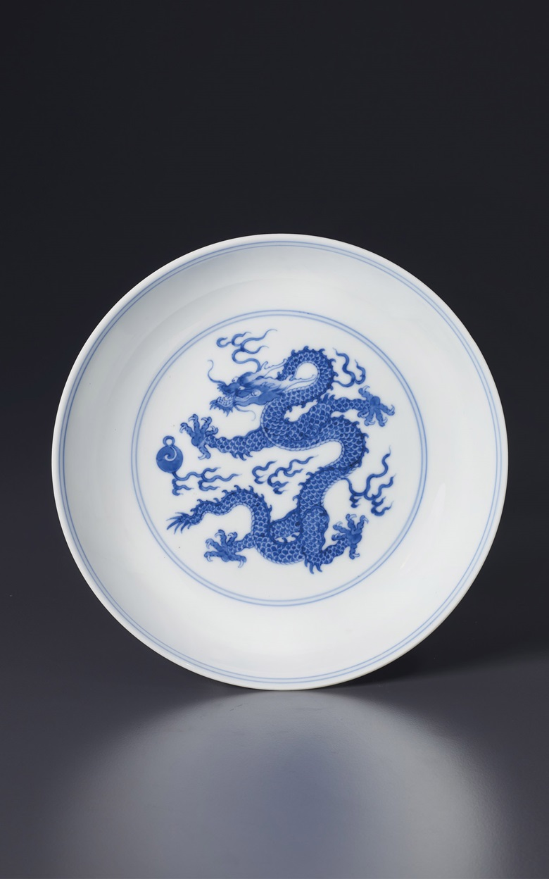 A blue and white Dragon dish, China, Qing dynasty, Yongzheng six-character mark in underglaze blue within a double circle and of the period (1723-1735). 7⅛ in (18.2 cm)  diam. Estimate $30,000-50,000. Offered in Sacred and Imperial The James and Marilynn Alsdorf Collection Part II on 24 September at Christie's in New York