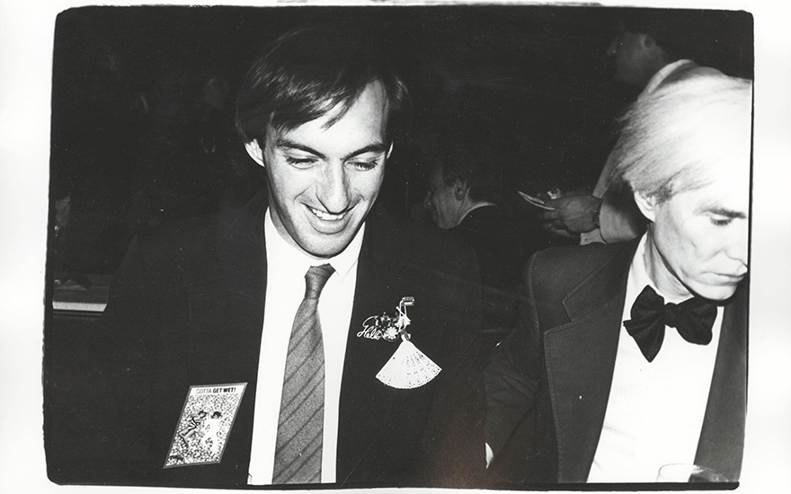 Andy Warhol (1928-1987), Jon Gould and Andy Warhol, executed circa 1982. Unique gelatin silver print. 8 x 10 in (20.3 x 25.4 cm). Photograph  © 2020 The Andy Warhol Foundation for the Visual