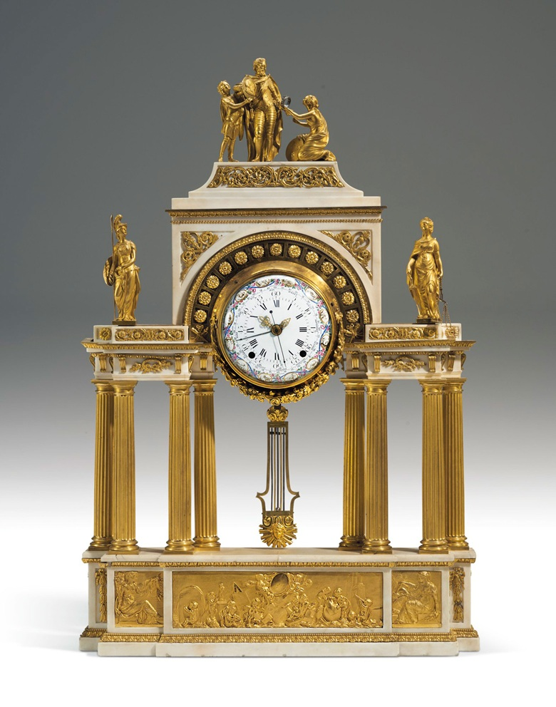 A Louis XVI ormolu and white marble portico clock, circa 1785. With Henri IV accepting the French crown above a portico with classical figures. 43 in (109 cm) high, 28½ in (72.5 cm) wide, 5½ in (12.5 cm) deep. Estimate $100,000–200,000. Offered in Dalva Brothers Parisian Taste In New York on 22 October 2020 at Christie's in New York