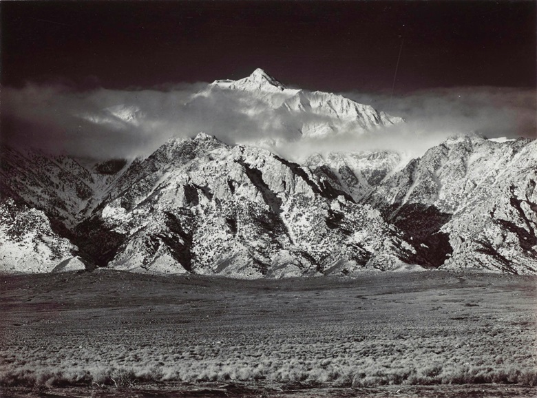 Ansel Adams (1902–1984), Mount Williamson, Sierra Nevada, from the Owens Valley, California, 1944. Gelatin silver print, mounted on board, signed in ink (mount, recto); titled on affixed artists label (mount, verso). Imagesheet 7 x 9⅜ in (17.8 x 23.8 cm), mount 14 x 17⅞ in (35.6 x 45.4 cm). Estimate $12,000-18,000. Offered in Ansel Adams and the American West Photographs from the Center for