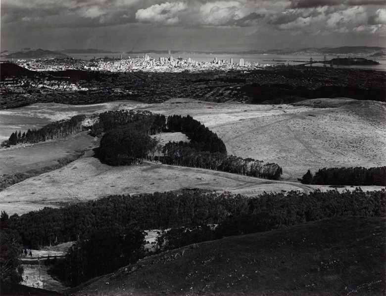 Ansel Adams (1902–1984), San Francisco from San Bruno Mountain, California, 1952. Gelatin silver print, mounted on board, signed in pencil (mount, recto); titled in ink in photographers Carmel credit stamp [BMFA 11] (mount, verso). Imagesheet 14⅛ x 18⅜ in (35.9 x 46.7 cm), mount 21.1516 x 27⅞ in (55.8 x 70.8 cm). Estimate $10,000-15,000. Offered in Ansel Adams and the American West