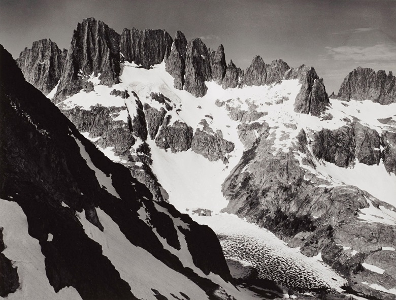 Ansel Adams (1902–1984), The Minarets and Iceberg Lake from Volcanic Ridge, Sierra Nevada, California, c. 1935. Gelatin silver print, mounted on board, printed 1978, signed in pencil (mount, recto); titled and dated in ink in photographers Carmel credit stamp (mount, verso). Mount 15⅞ x 19⅞ in (40.5 x 50.5 cm). Estimate $4,000-6,000. Offered in Ansel Adams and the American West Photographs