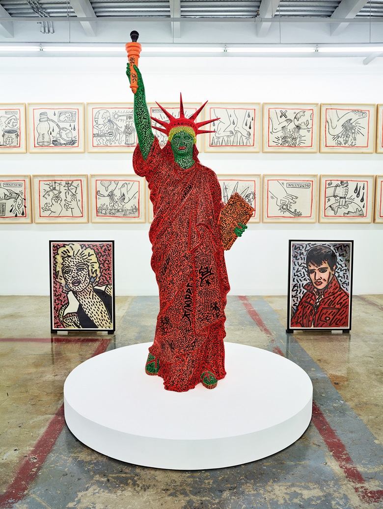Installation view of Keith Haring artworks including, clockwise from back, Untitled (Against All Odds), 1989 (detail); Elvis Presley, 1981; Statue of Liberty, 1982 (collaboration with LA II); Marilyn Monroe, 1981. The Rubells began collecting works by Haring in the early days of the artist's career, in 1981. Keith Haring artwork © Keith Haring Foundation