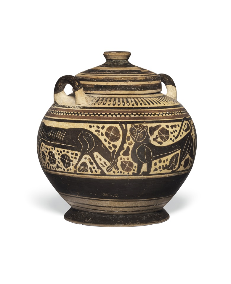 A Corinthian black-figured lidded pyxis, circa 600-575 BC. 6½ in (16.5 cm) high. Estimate $5,000-7,000. Offered in Antiquities on 2-16 June 2020 at Christie's online