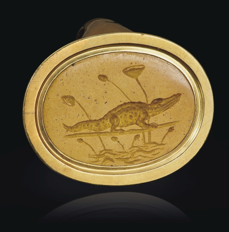 A Greek yellow jasper ringstone with a crocodile, Alexandria, Hellenistic Period, circa 2nd-1st century BC. ¾ in (1.9 cm) long. Estimate $7,000-9,000. Offered in Masterpieces in Miniature Ancient Engraved Gems formerly in the G. Sangiorgi Collection Part II, 2-16 June 2020, Online