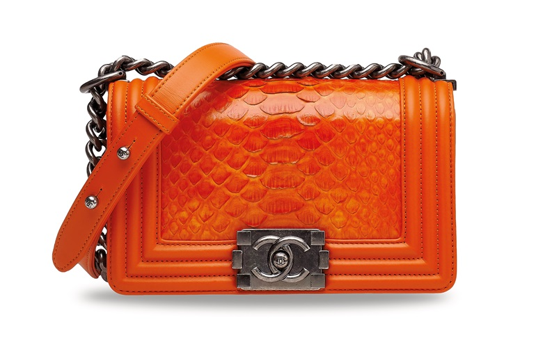 A shiny orange python small boy with ruthénium hardware, Chanel, 2014. 20 w x 12 h x 6 d cm. Estimate HK$26,000-30,000. Offered in Handbags & Accessories  on 10 July 2020 at Christie's in Hong Kong