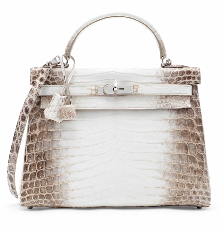 A rare, matte white Himalaya Niloticus Crocodile Retourné Kelly 32 with palladium hardware, Hermès, 2014. Sold for £100,000 on 12 June 2017 at Christie's in London